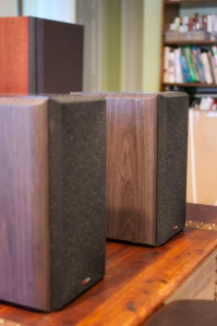 Polk Lsi7. Hefty ebony side veneers. Top and bottom are piano-black